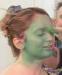 Felicia Ricci is painted green to play the role of Elphaba in Wicked
