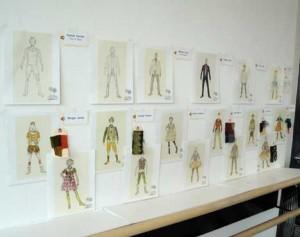 Godspell Broadway costumes designs on wall